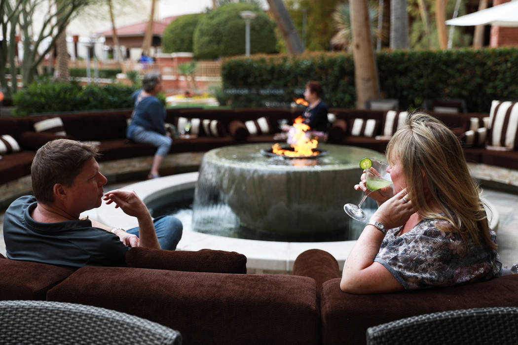 Brandon Koch and his wife Jill, both locals, enjoy drinks at T-Bones Chophouse at Red Rock Casino Resort & Spa in Las Vegas on Monday, April 2, 2018. (Andrea Cornejo/Las Vegas Review-Journal @drea ...