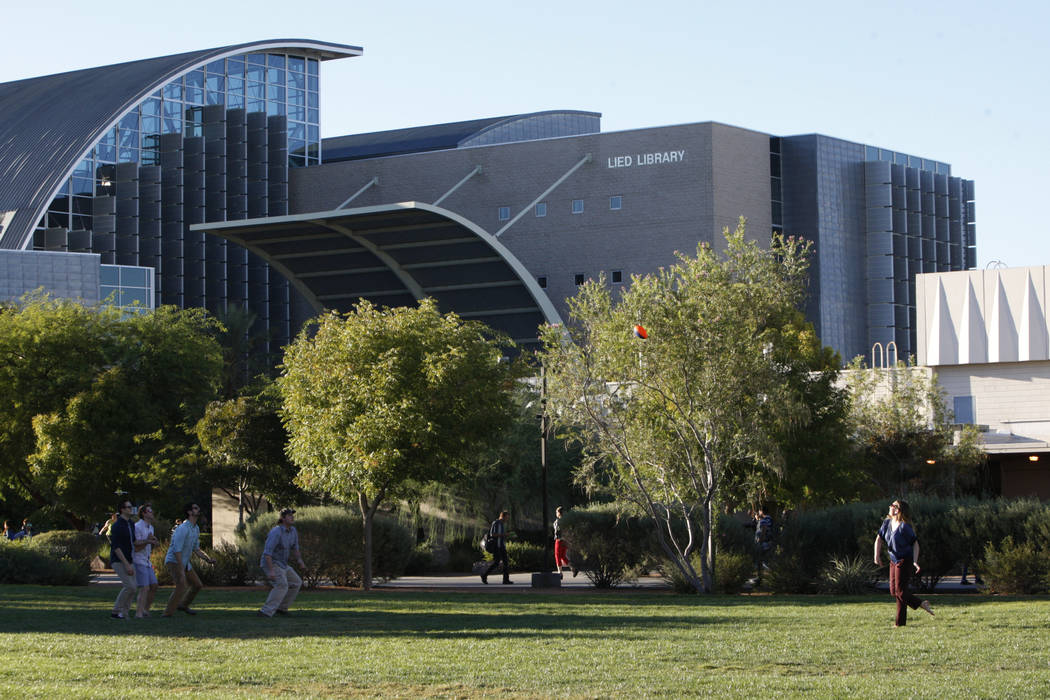 Students plays football near Lied Library at UNLV in Las Vegas Thursday, Oct. 2, 2014. (Erik Verduzco/Las Vegas Review-Journal)