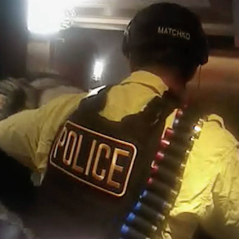 This screen grab from body camera footage released by Las Vegas police, Wednesday, May 2, 2018, shows the moment officers breached the Oct. 1 gunmanճ Mandalay Bay suite. Metropolitan Police ...