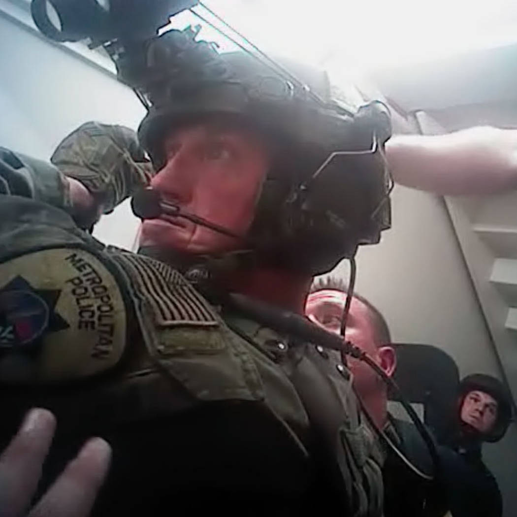This screen grab from body camera footage released by Las Vegas police, Wednesday, May 2, 2018, shows the moment officers breached the Oct. 1 gunman's Mandalay Bay suite. Metropolitan Police Depar ...