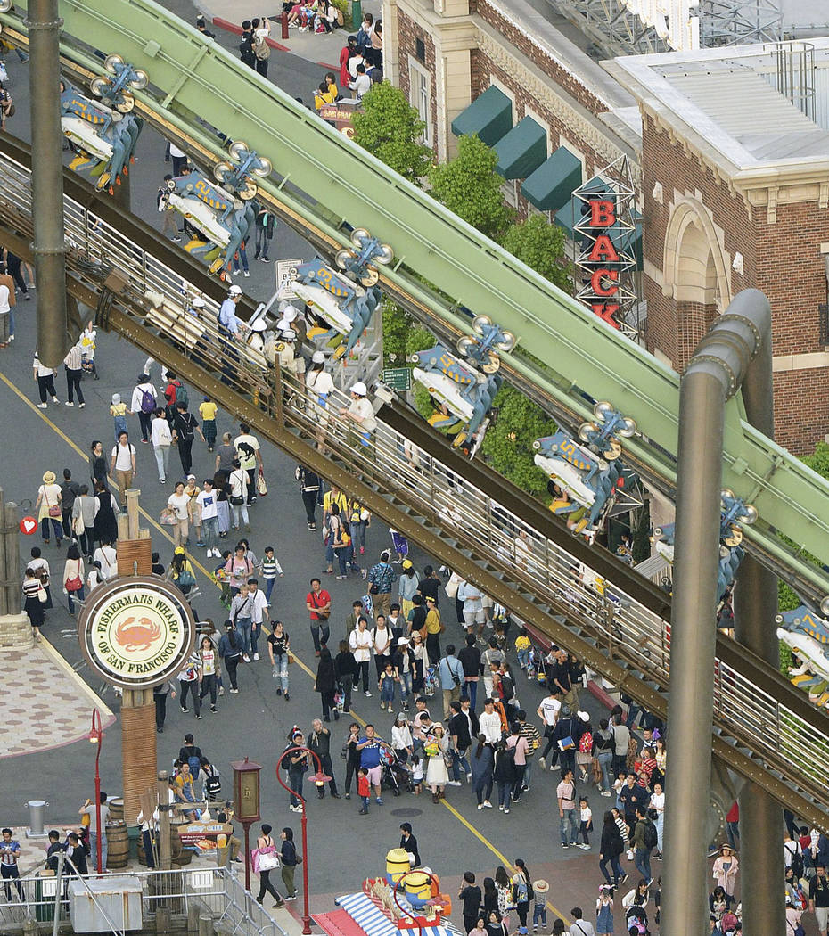In this Tuesday, May 1, 2018, photo, passengers are rescued from the stopped Flying Dinosaur rollercoaster at Universal Studios Japan amusement park in Osaka, western Japan. Sixty-four passengers ...