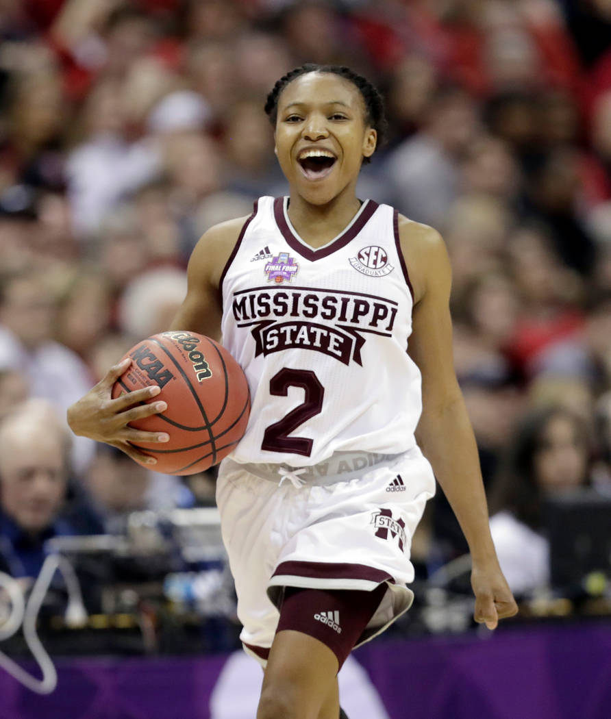 Mississippi State's Morgan William celebrates during overtime against Louisville in the semifinals of the women's NCAA Final Four college basketball tournament, Friday, March 30, 2018, in Columbus ...