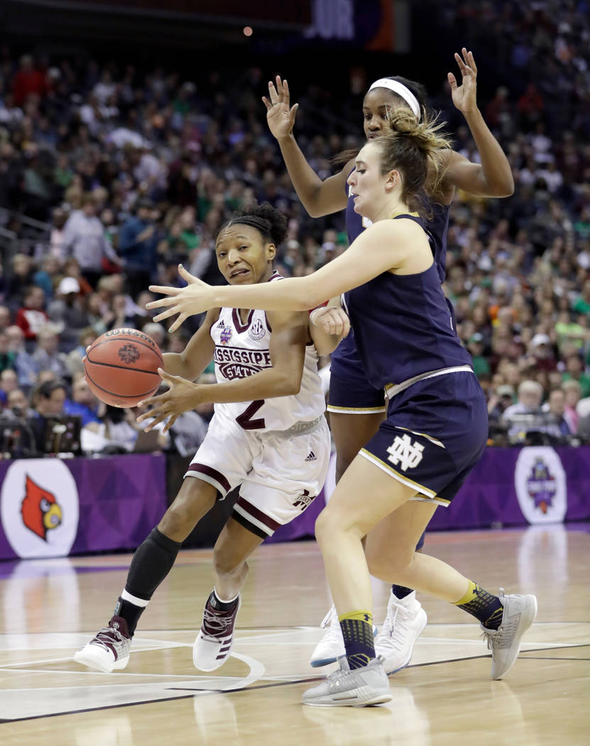 Mississippi State's Morgan William, left, heads to the basket past Notre Dame's Marina Mabrey during the second half in the final of the women's NCAA Final Four college basketball tournament, Sund ...