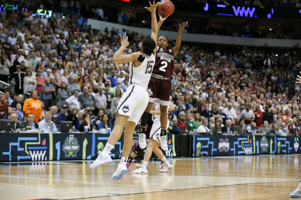 Mississippi State guard Morgan William (2) shoots a buzzer beater over Connecticut guard Gabby Williams (15) during an NCAA college basketball game in the semifinals of the women's Final Four, Sat ...