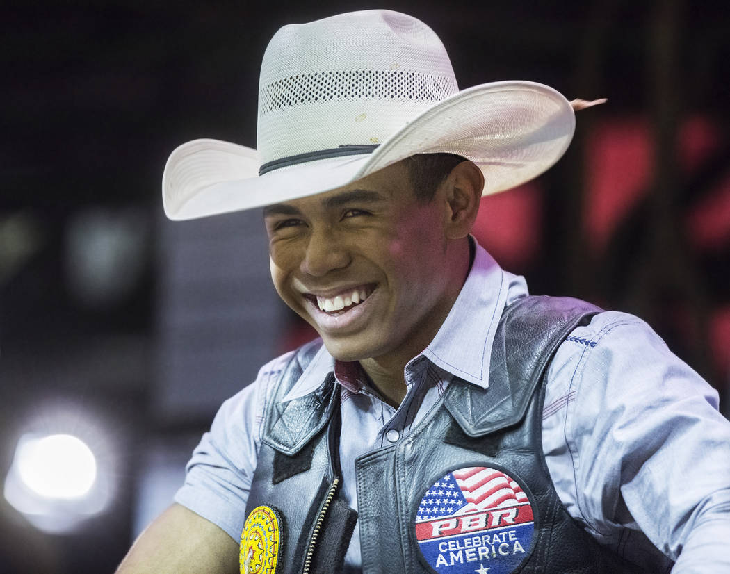 Keyshawn Whitehorse shares a laugh with fellow riders during the Professional Bull Rider's Last Cowboy Standing competition on Friday, May 4, 2018, at the Thomas & Mack Center, in Las Vegas. B ...
