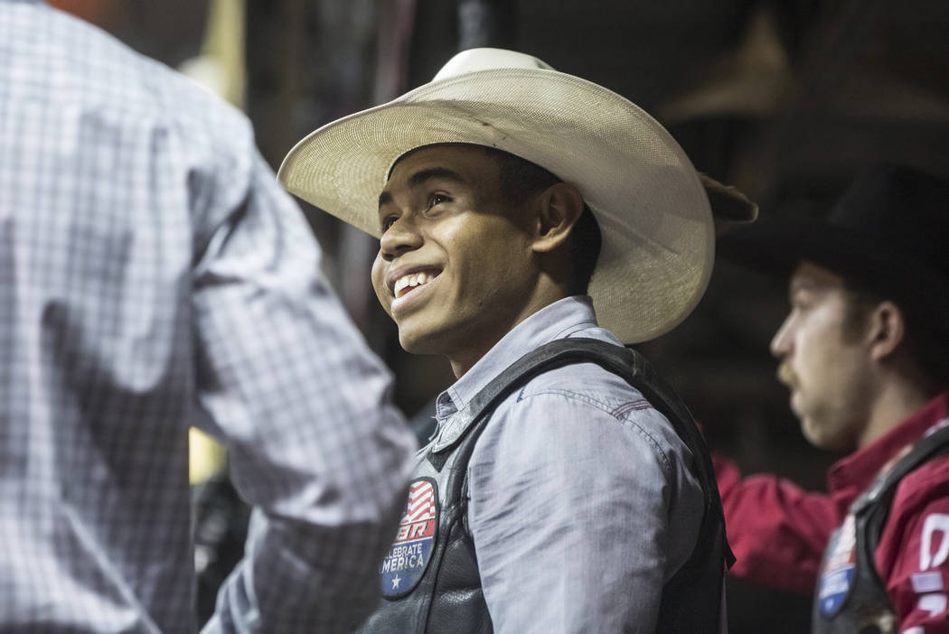 Keyshawn Whitehorse, middle, interacts with other riders during the Professional Bull Rider's Last Cowboy Standing competition on Friday, May 4, 2018, at the Thomas & Mack Center, in Las Vegas ...