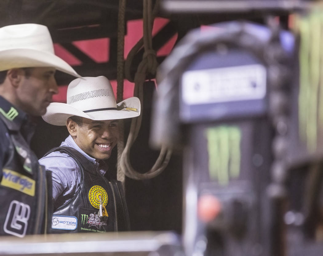 Keyshawn Whitehorse, second from left, interacts with other riders during the Professional Bull Rider's Last Cowboy Standing competition on Friday, May 4, 2018, at the Thomas & Mack Center, in ...