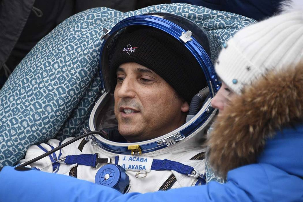 In this Feb. 28, 2018 file photo NASA astronaut Joe Acaba rests in a chair after landing in a remote area south-east of the Kazakh town of Zhezkazgan, Kazakhstan. (Alexander Nemenov/Pool Photo vi ...