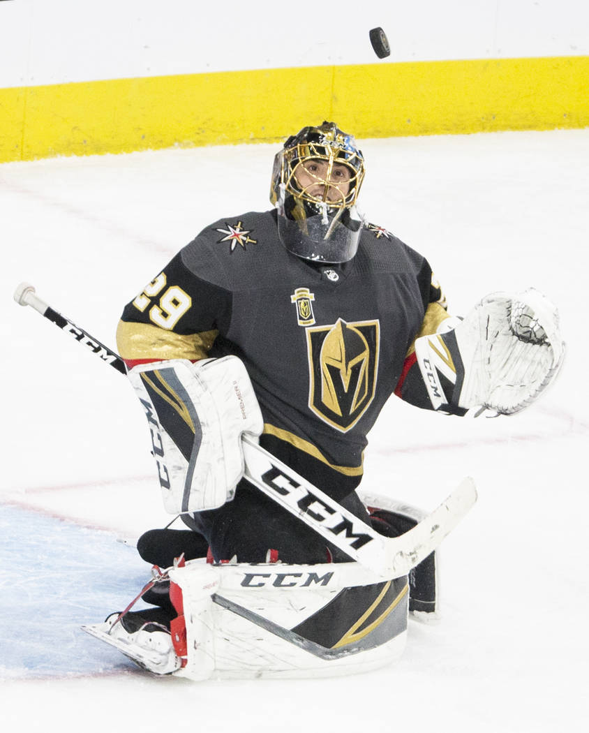 Golden Knights goaltender Marc-Andre Fleury (29) makes a save against in overtime during game two of their second round playoff series on Saturday, April 28, 2018, at T-Mobile Arena, in Las Vegas. ...