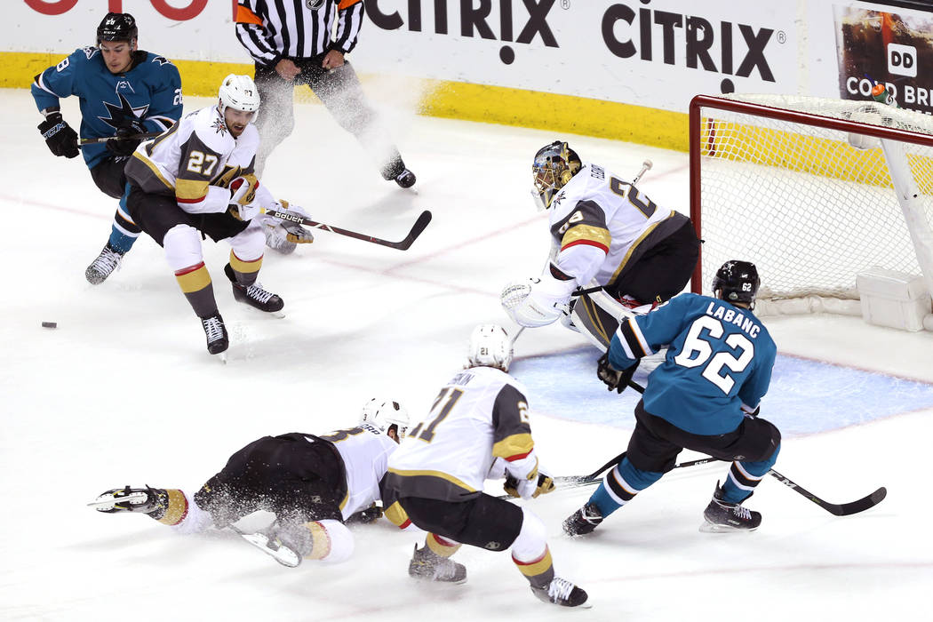 Vegas Golden Knights defend against the San Jose Sharks during the second period in Game 4 of an NHL hockey second-round playoff series at the SAP Center in San Jose, Calif, Wednesday, May 2, 2018 ...