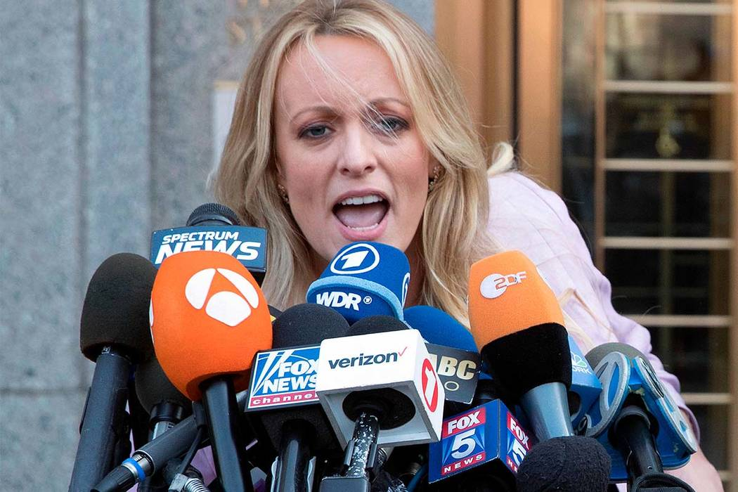 President Donald Trump acknowledged Thursday he repaid his personal lawyer for hush money given to porn actress Stormy Daniels, seen in an April 16, 2018, photo, after claiming previously he didn' ...