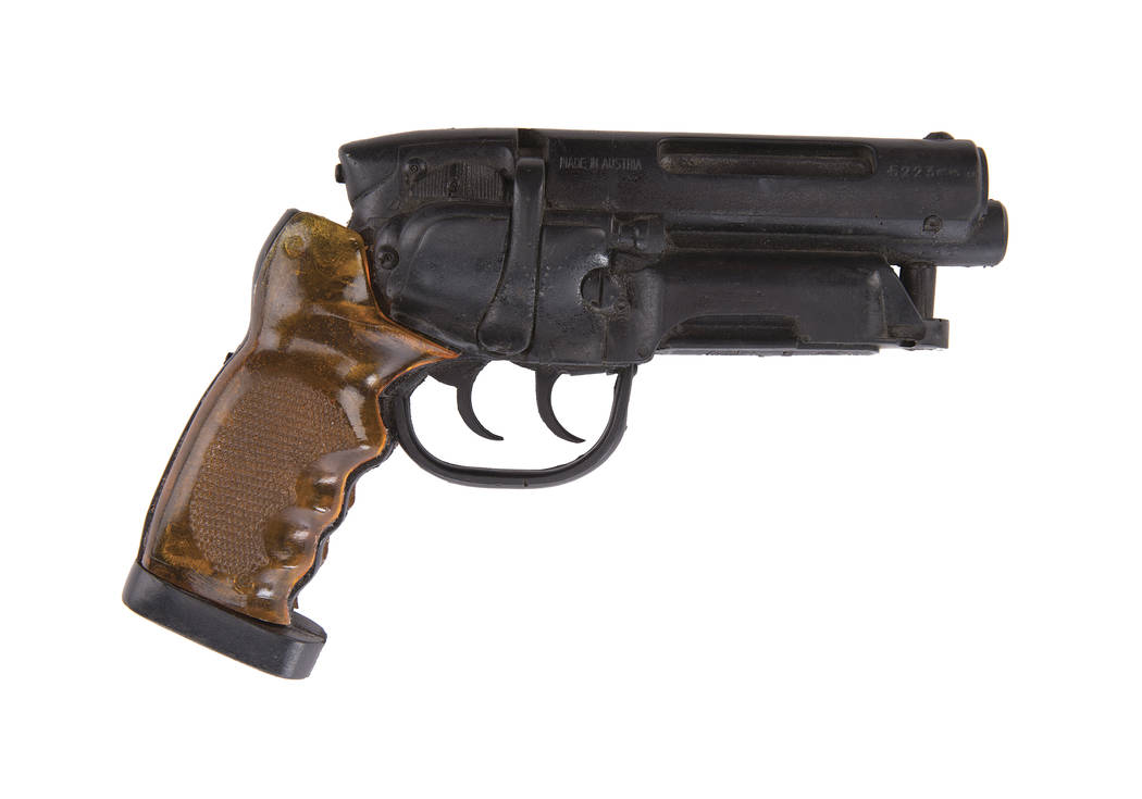 """This image released by Profiles in History shows a prop blaster used by Harrison Ford in the 1982 film, """"Blade Runner,"""" which is among the items from Hollywood films up for auction in Ju ..."""