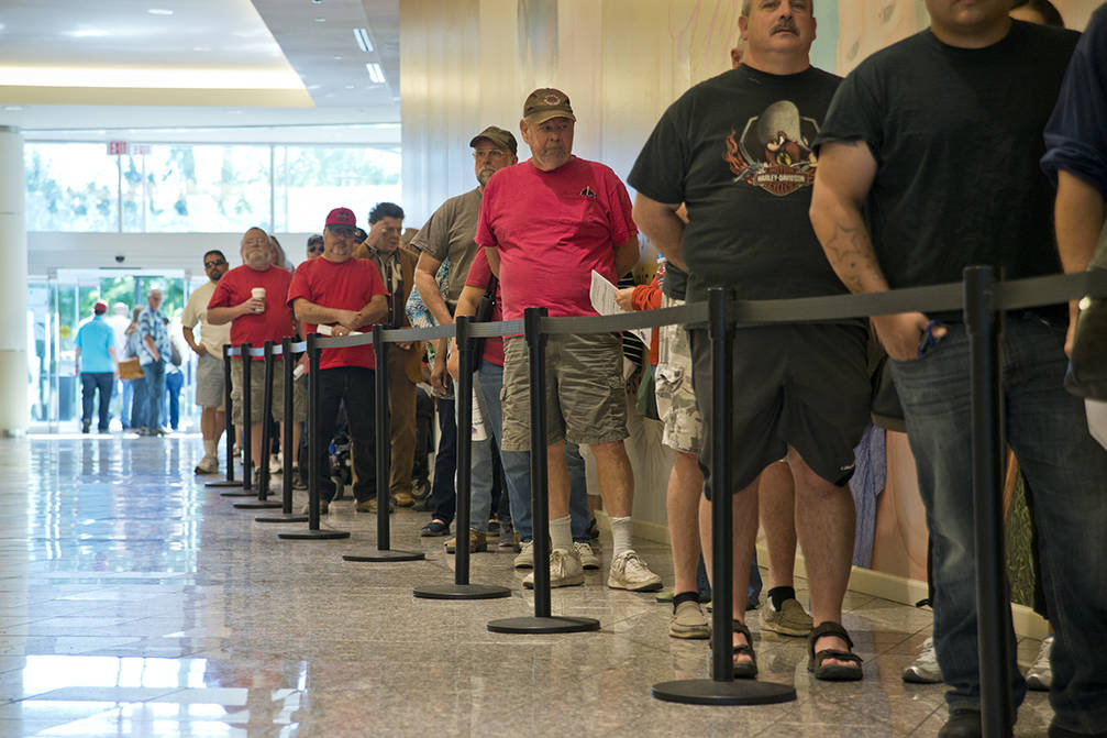 These voters stand in line to be among the first to vote in Nevada during early voting at the Galleria at Sunset in Henderson on Saturday morning, Oct. 22, 2016. Early voting for Nevada's midter ...