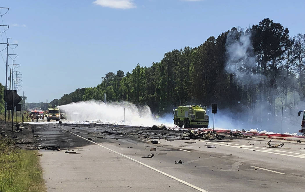 Emergency personnel work at the scene of an Air National Guard C-130 cargo plane that crashed near Savannah, Ga., Wednesday, May 2, 2018. (Chris Hanks/Savannah Professional Firefighters Associatio ...