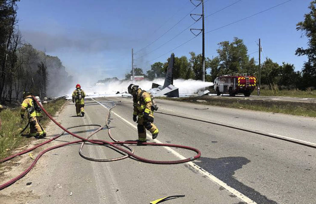This photo made available by the Chatham Emergency Services, GA., shows firefighters putting out a fire caused by a plane crash near the airport in Savannah, Ga., Wednesday, May 2, 2018. An Air Na ...