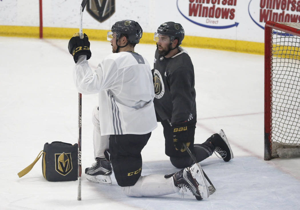 Vegas Golden Knights center Ryan Carpenter, left, and Brad Hunt chat as they take a break during team's optional practice at the City National Arena on Thursday, May 3, 2018, in Las Vegas. Bizuaye ...