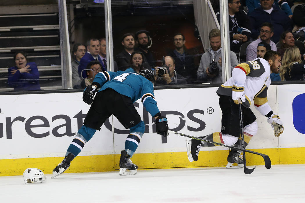 Vegas Golden Knights left wing William Carrier (28) loses his helmet after getting hit by San Jose Sharks defenseman Brenden Dillon (4) during the third period in Game 4 of an NHL hockey second-ro ...