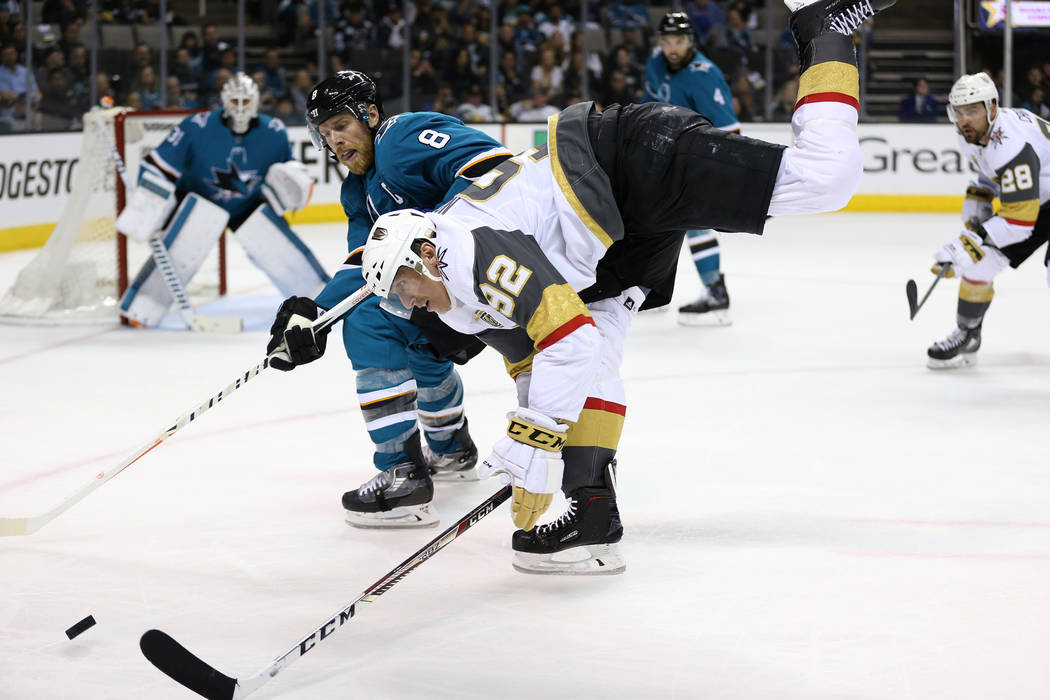 Vegas Golden Knights left wing Tomas Nosek (92) goes for the puck against San Jose Sharks center Joe Pavelski (8) during the third period in Game 4 of an NHL hockey second-round playoff series at ...