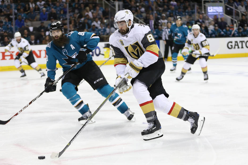 Vegas Golden Knights right wing Alex Tuch (89) goes for the puck against San Jose Sharks defenseman Brent Burns (88) during the third period in Game 4 of an NHL hockey second-round playoff series ...