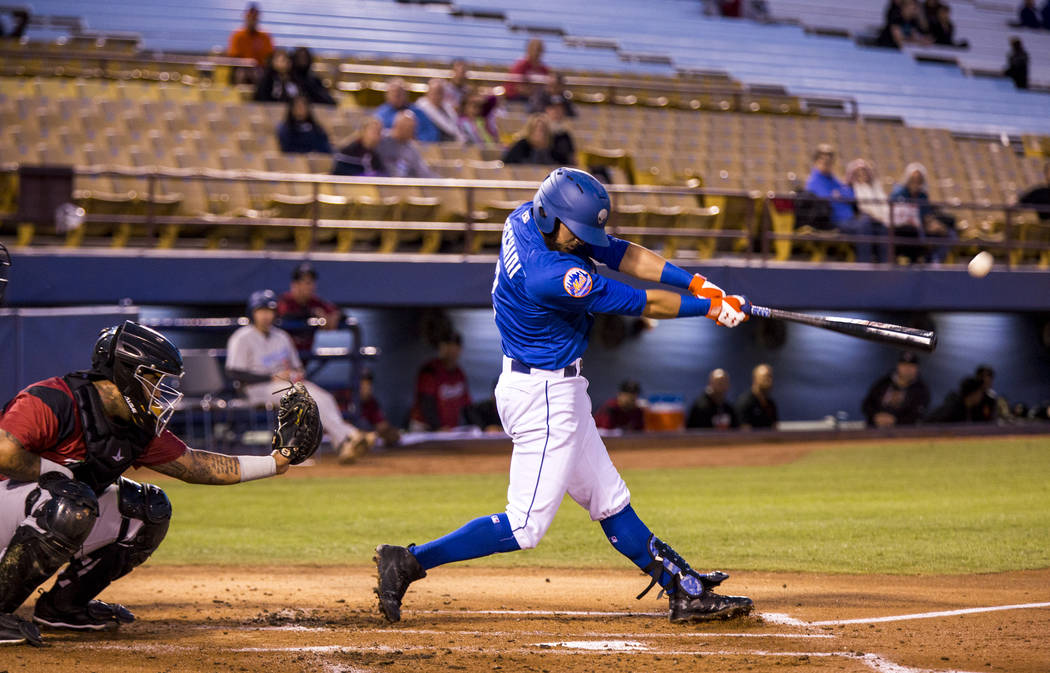 Las Vegas 51s second baseman Gavin Cecchini makes a hit while playing against the Sacramento River Cats at Cashman Field on Wednesday, May 2, 2018. Patrick Connolly Las Vegas Review-Journal @PConnPie