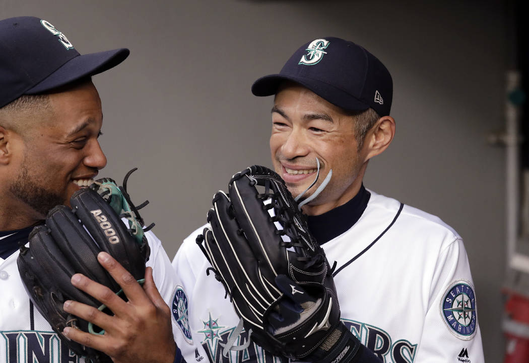Seattle Mariners' Ichiro Suzuki, right, and Robinson Cano laugh before the team's baseball game against the Oakland Athletics on Wednesday, May 2, 2018, in Seattle. (AP Photo/Elaine Thompson)
