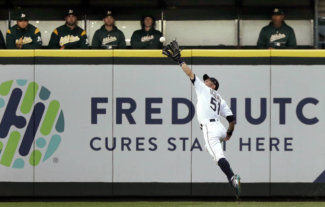 Seattle Mariners right fielder Ichiro Suzuki catches a fly ball from Oakland Athletics' Matt Chapman during the second inning of a baseball game Wednesday, May 2, 2018, in Seattle. (AP Photo/Elain ...