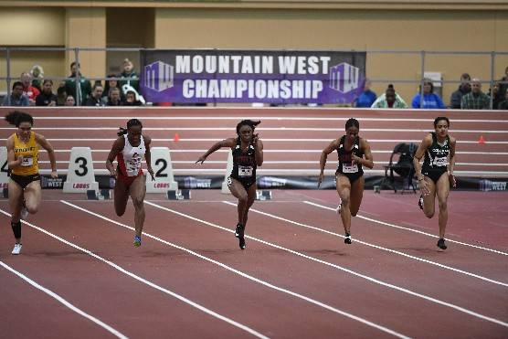 Jasmyne Graham (middle) and Destiny Smith-Barnett (second from the right) compete for UNLV in the Mountain West Indoor Championships. Photo courtesy of UNLV Athletics.