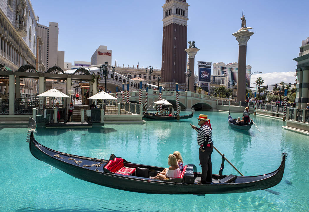 "Golden Knights national anthem singer Carnell Johnson, also known as ""Golden Pipes,"" takes Rani Spokes and Bree Hooper of Australia for a gondola ride outside the Venetian in Las Vegas o ..."