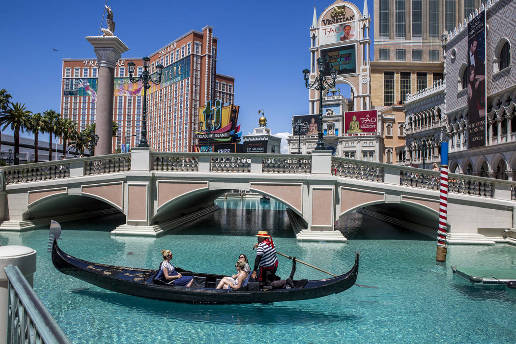 "Golden Knights national anthem singer Carnell Johnson, also known as ""Golden Pipes,"" takes Scottish visitors Alexandra Orr, Michelle Brooks and Natasha Anderson for a gondola ride outsid ..."