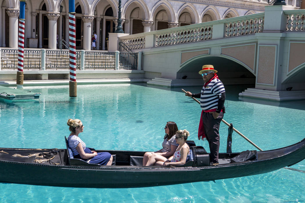 "Golden Knights national anthem singer Carnell Johnson, also known as ""Golden Pipes,"" takes Scottish visitors, from left, Alexandra Orr, Michelle Brooks and Natasha Anderson for a gondola ..."