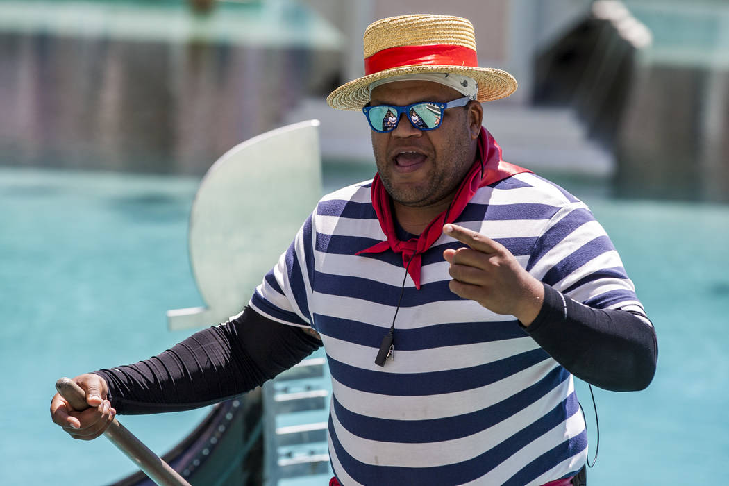 "Golden Knights national anthem singer Carnell Johnson, also known as ""Golden Pipes,"" sings for Scottish visitors on a gondola ride outside the Venetian in Las Vegas on Thursday, May 3, 2 ..."