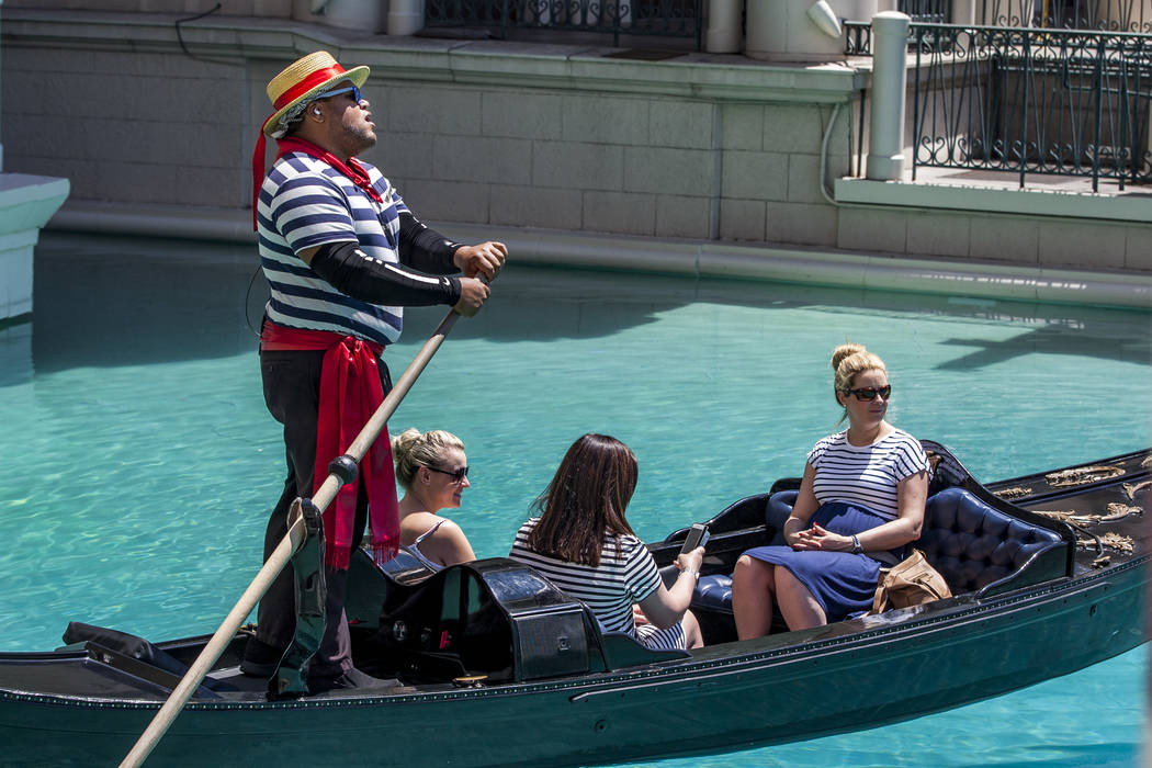 "Golden Knights national anthem singer Carnell Johnson, also known as ""Golden Pipes,"" takes Scottish visitors, from left, Natasha Anderson, Michelle Brooks and Alexandra Orr for a gondola ..."