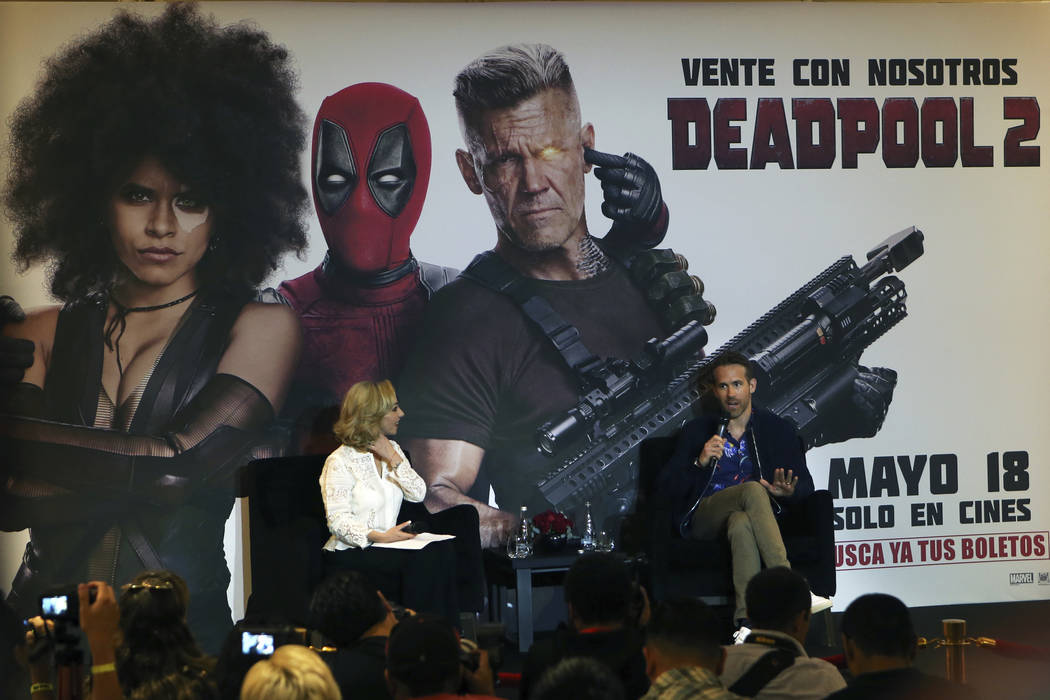 "Actor Ryan Reynolds, right, gives a press conference to promote film ""Deadpool 2"" in Mexico City, Wednesday, April 25, 2018. (AP Photo/Marco Ugarte)"