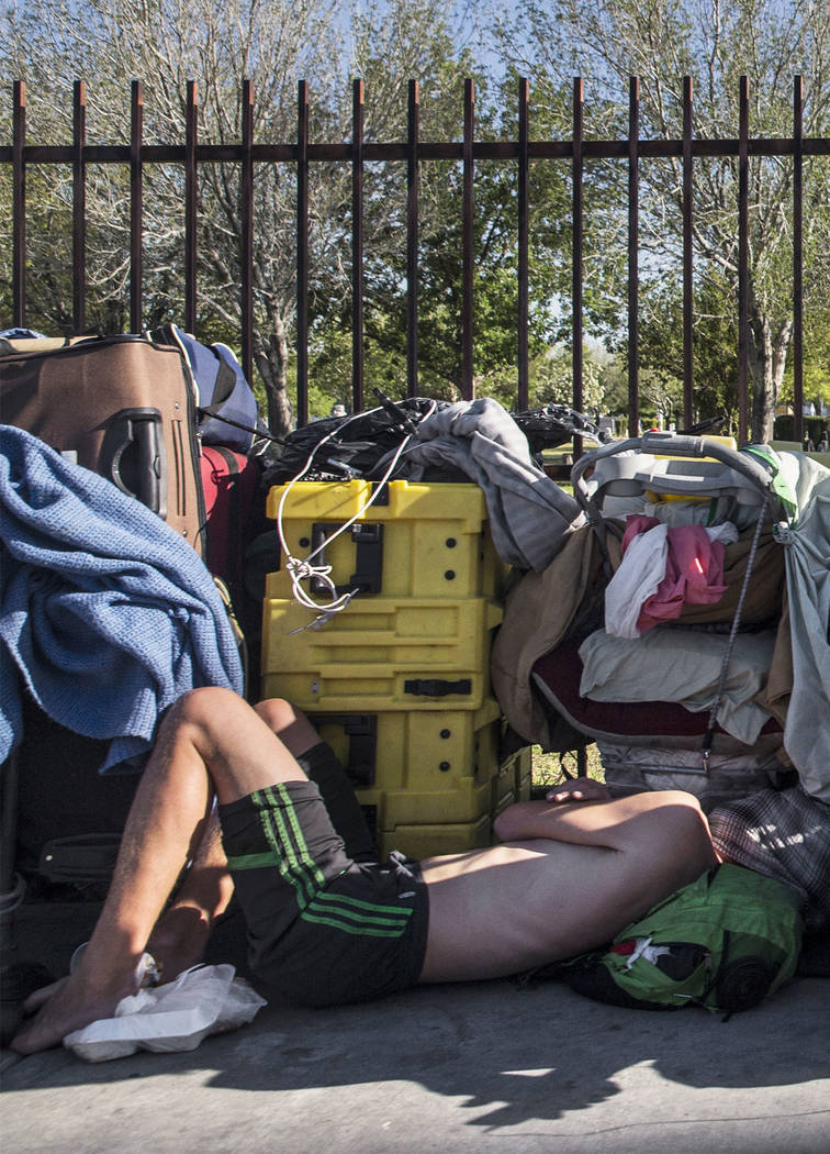 A man sleeps on the ground on East Owens Avenue on Thursday, May 3, 2018, in Las Vegas. Benjamin Hager Las Vegas Review-Journal @benjaminhphoto