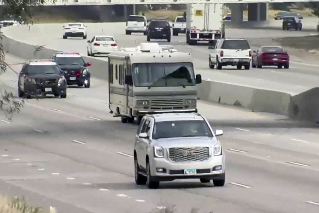 Police chase an RV along a north bound highway in Kern County, Calif., on Tuesday. (23-ABC-TV Bakersfield via AP)