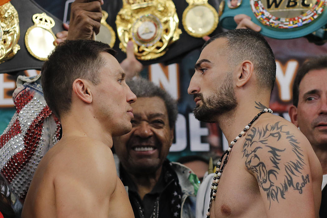 Gennady Golovkin, left, faces off with Vanes Martirosyan during a weigh-in Friday, May 4, 2018, in Los Angeles. Golovkin will defend his middleweight title against Martirosyan in a boxing match Sa ...