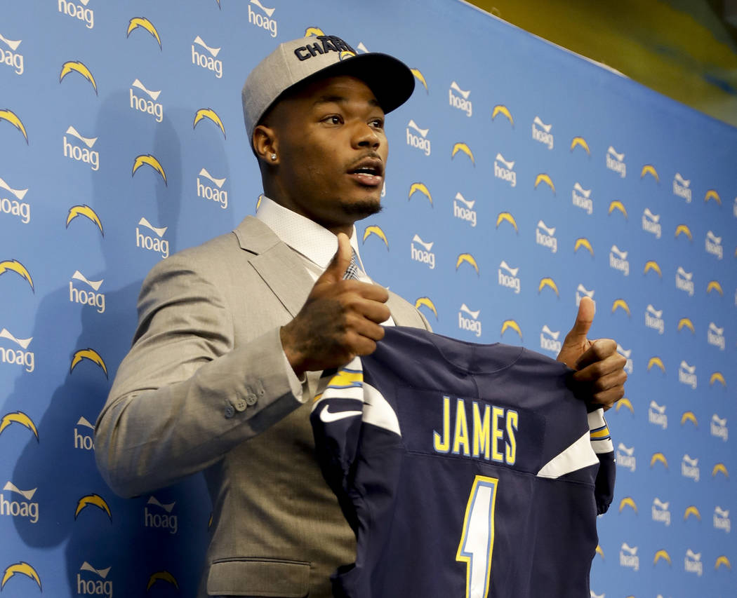 Derwin James, drafted by he Los Angeles Chargers, poses for a picture during a news conference, Friday, April 27, 2018 in Costa Mesa, Calif. The Chargers selected defensive back James, out of Flor ...