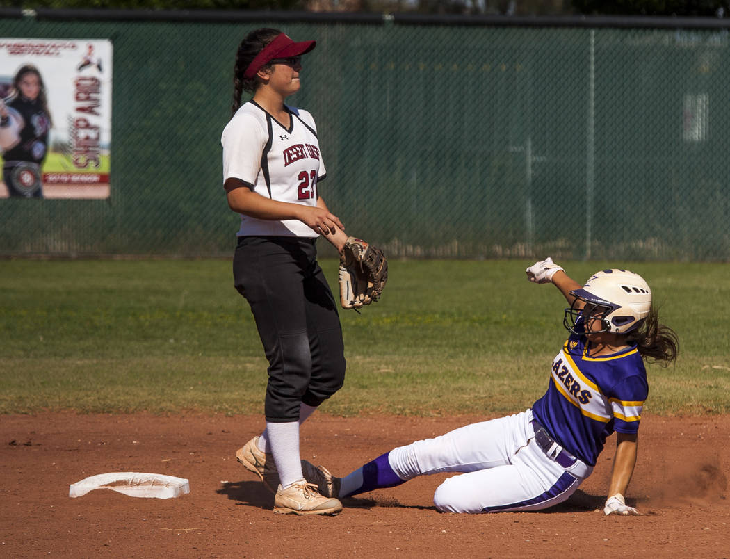 Durango infielder Destiny Cisneros slides in safe at second as Desert Oasis infielder Makayla Rickard waits for a play in the second inning at Desert Oasis High School in Las Vegas on Thursday, Ma ...