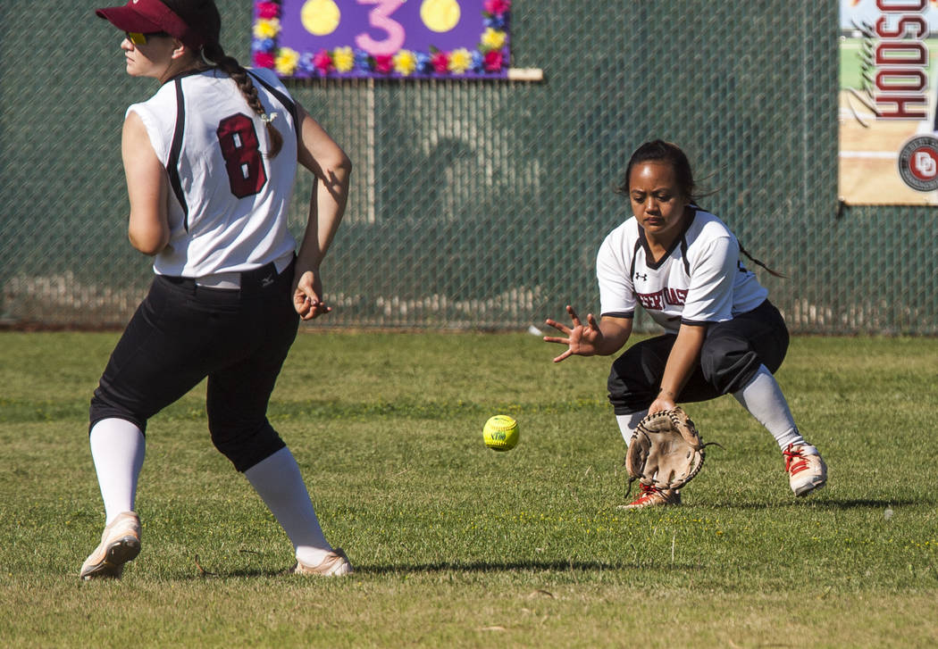 Desert Oasis outfielder Izriah Hodson scoops up a ground ball with Maggie Shepard next to her while playing against Durango in the third inning at Desert Oasis High School in Las Vegas on Thursday ...