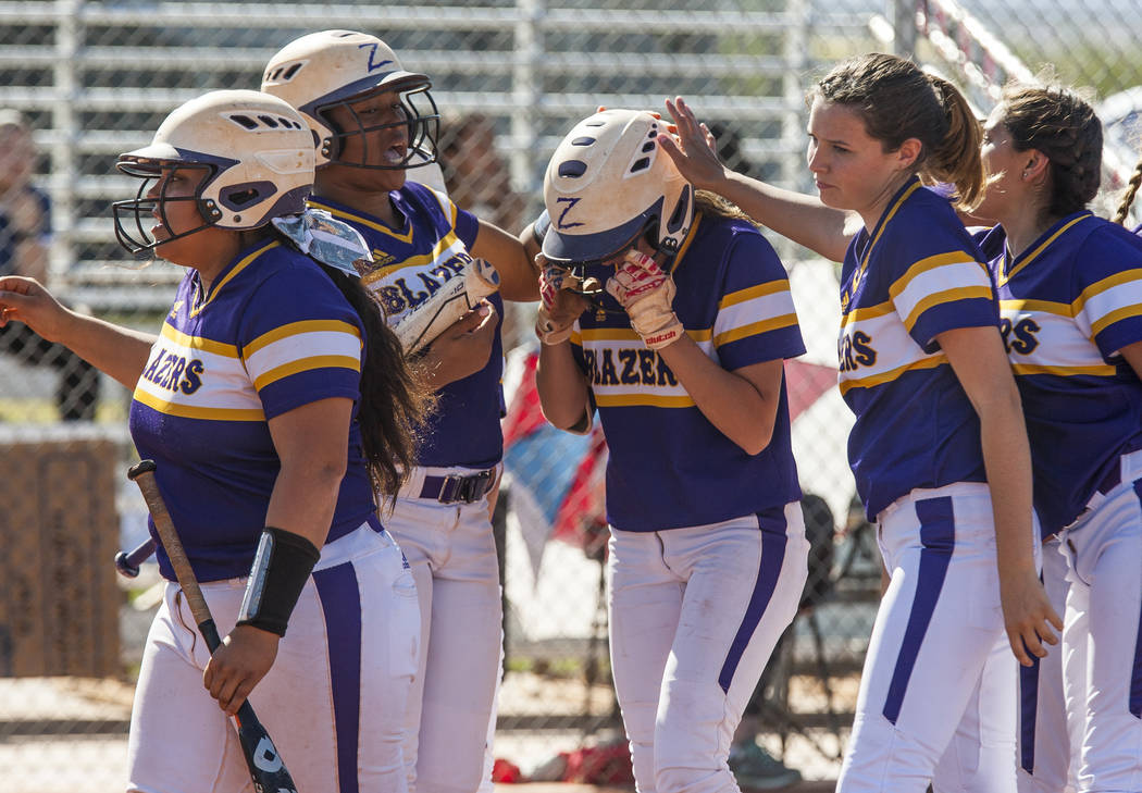 Durango players pat Kaitlin Fazendin on the helmet after she scored a two-run home run and also brought Madisyn Conriquez home while playing against Durango in the third inning at Desert Oasis Hig ...