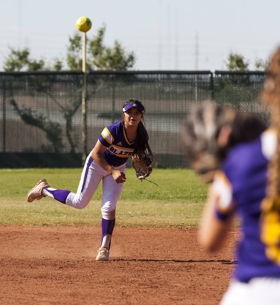 Durango infielder Destiny Cisneros throws toward Madison Boyce at first base to make a play against Desert Oasis during the third inning at Desert Oasis High School in Las Vegas on Thursday, May 3 ...