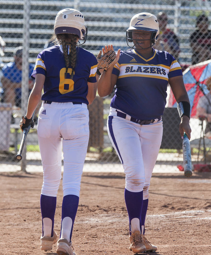 Durango infielder Madison Boyce, left, high fives pitcher Trinity Valentine after Valentine scored in the fourth inning against Desert Oasis at Desert Oasis High School in Las Vegas on Thursday, M ...