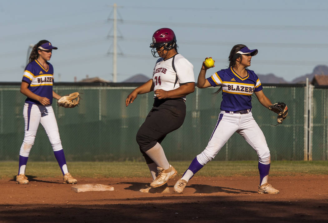 Durango infielder Destiny Cisneros looks for a play at first after tagging Desert Oasis' Fia Tofi out at second in the sixth inning at Desert Oasis High School in Las Vegas on Thursday, May 3, 201 ...