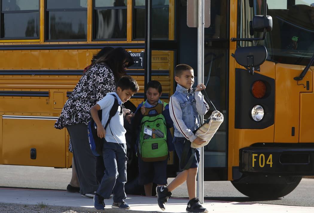 Several Arizona schools resume classes as students return to Tuscano Elementary School Thursday, May 3, 2018, in Phoenix. (AP Photo/Ross D. Franklin)
