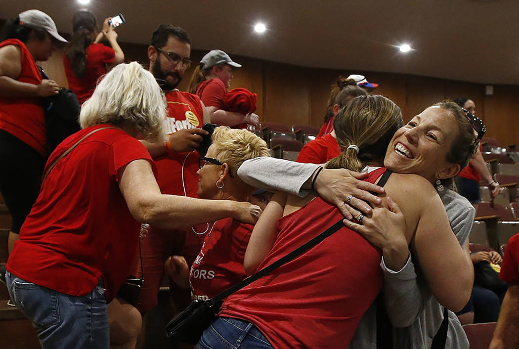 Teachers embrace in the Arizona House of Representatives gallery during continued protests as budget legislation nears the end of session at the Arizona Capitol Thursday, May 3, 2018, in Phoenix. ...