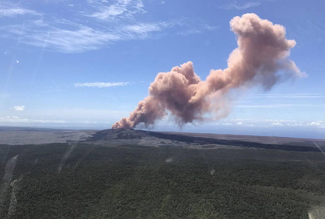 Red ash rises from the Puu Oo vent on Hawaii's Kilauea Volcano after a magnitude-5.0 earthquake struck the Big Island, Thursday, May 3, 2018 in Hawaii Volcanoes National Park. (Kevan Kamibayashi/U ...