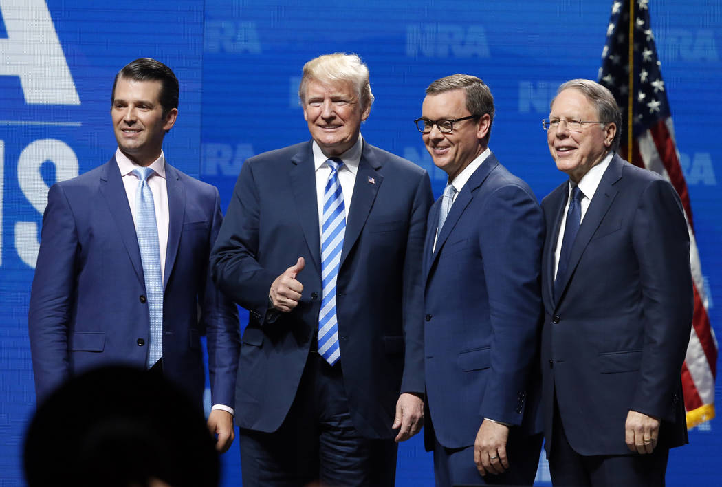 Donald Trump Jr., from left, President Donal Trump, Chris Cox, executive director of the National Rifle Association-Institute for Legislative Action Leadership Forum and NRA executive vice preside ...