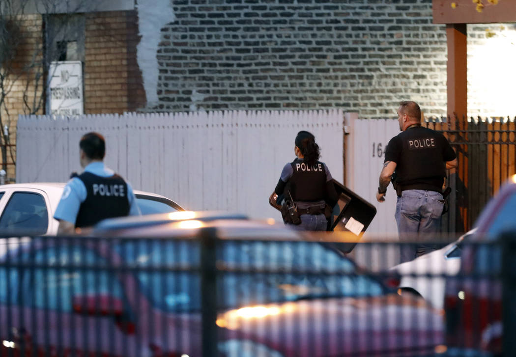 Chicago police work the scene near the area where a federal agent was shot and critically wounded in Chicago while working on an investigation with local authorities on Friday, May 4, 2018. (Jose ...