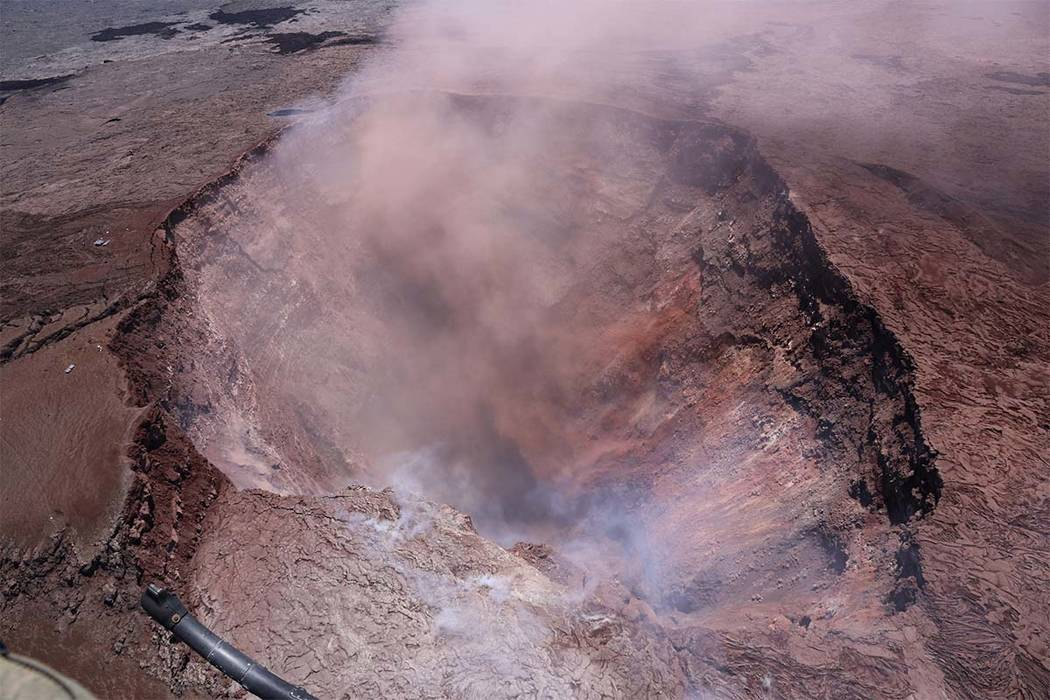 In this photo released by U.S. Geological Survey, a plume of ash rises from the Puu Oo vent on Hawaii's Kilaueaa Volcano Thursday, May 3, 2018 in Hawaii Volcanoes National Park. Hawaii's Kilauea v ...