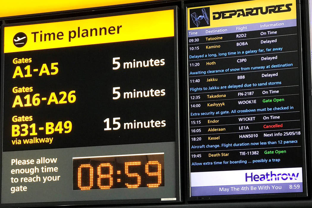 "A departure board at London's Heathrow Airport features ""Star Wars"" galaxy locations and characters. (@HeathrowAirport/Twitter)"